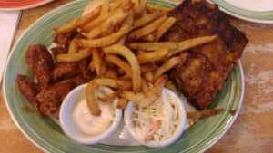 Ribs, chicken wings and fries