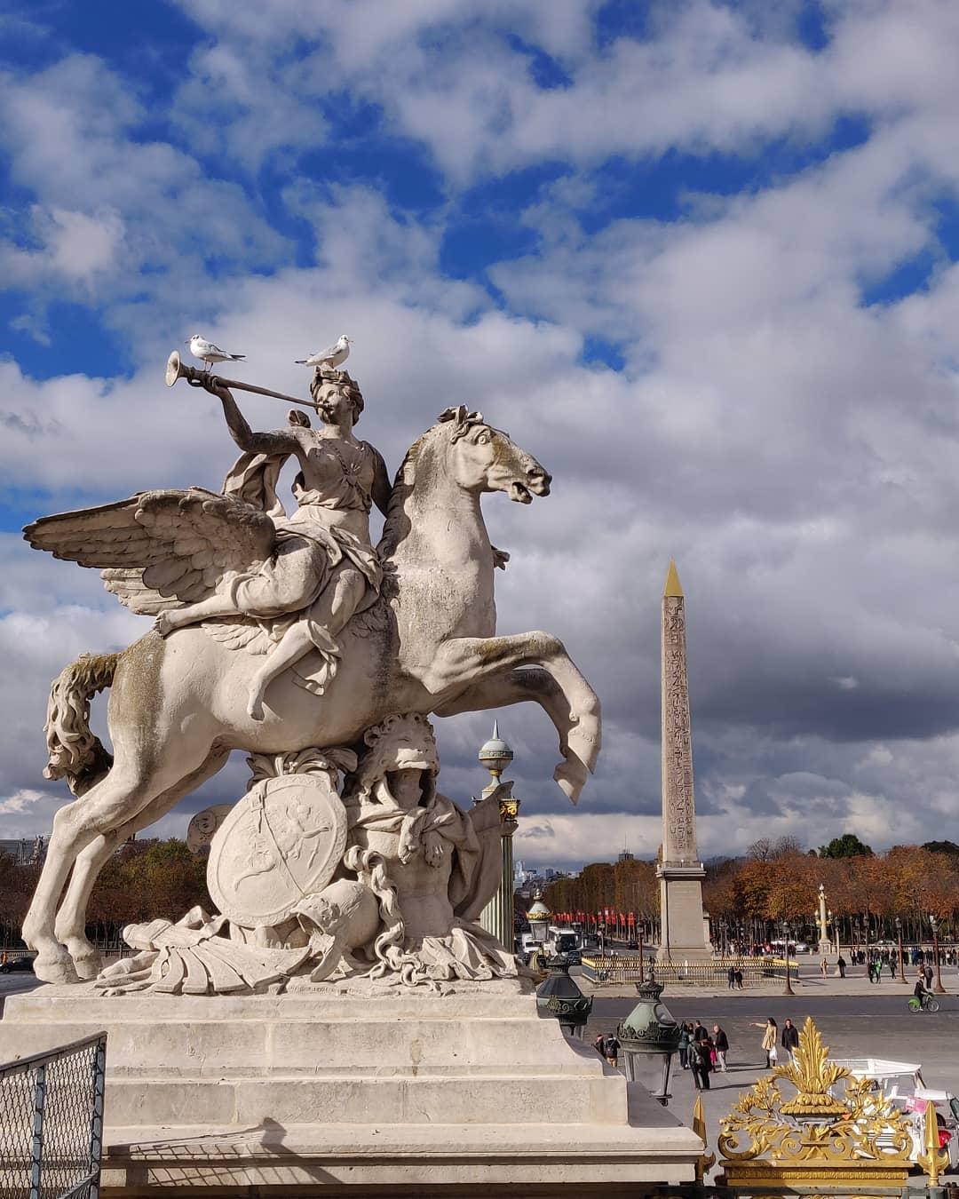 A statue from the Tuileries Garden in Paris. The obelisk of Luxor in Place de la Concorde